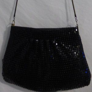Black zip up purse with black shiny sequin